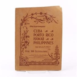 """1899 """"Picturesque: Cuba, Porto Rico, Hawaii and the Philippines"""": An antique paperback copy of Picturesque: Cuba, Porto Rico, Hawaii and the Philippines: A Photographic Panorama of our New Possessions. The book features over three hundred illustrations and photographs depicting the life of the areas and US military involvement there. It was published in 1899 by Mast, Crowell & Kirkpatrick."""