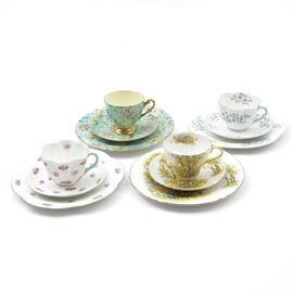 Collection of Shelley China Luncheon Sets: A collection of four Shelley china luncheon sets. Includes: Daffodil Time, Blue Rock, Rosebud, and Melody patterns Shelly patterns. Each luncheon set includes a salad plate, a saucer, and a tea cup.