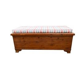 Vintage Cedar Chest with Bench Pillow: A vintage cedar chest with bench pillow. This rustic style cedar chest includes side handles and ogee bracket feet. Chest features the natural grain and knotting of the cedar wood with a nice warm finish.