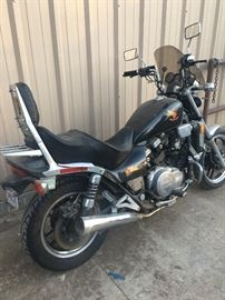 WAS $2200...FINAL REDUCTION TO $1400 CASH!           1986 Honda V65. Looks GREAT & SUPER SEXY! Has a very expensive Corbin Seat and a braided clutch line. Probably has a jet kit... I spoke with a guy at the shop that went through it a year ago and he said it's faster then H, E, Double Hockeysticks! was parked 6 months ago because it needs a new fuel line from the gas tank to the carburetor. Now it also needs a new battery, and the front brakes should be checked out because the master cylinder isn't holding pressure. CLEAN CLEAR BLUE TEXAS TITLE IN-HAND! This is a dream of an easy DIY project bike for someone who is even just a little bit mechanically capable. A little of time and gumption should bring this bike into the $2500-$3200 value range according to the shop.