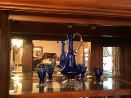 Funky blue glass decanter and 5 glasses.