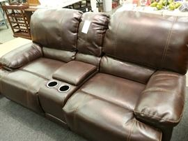 Same with the loveseat! Bad lighting! Dark brown, reclining with center console