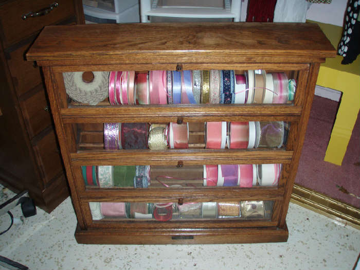 A.N. Russell and Sons oak ribbon cabinet circa 1900