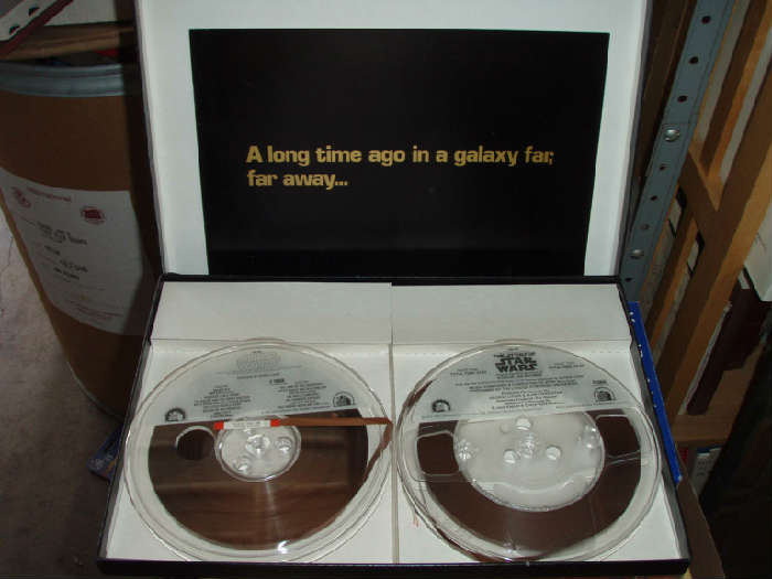 """Reel #1 (RN541) is a 4-track recording of the movie's soundtrack (Sounding all John Williams-like and produced by George Lucas)  Reel #2 (RN550) is a 4-track recording entitled: """"The Story of Star Wars"""" (""""Original cast with narration by Roscoe Lee Brown"""") Part 1 = 24:53 / Part 2 = 24:59 (time)  Includes near mint 16 page full color booklet.   No bends, no crinkles, no tears!  All is beautifully presented in an excellent condition box. No crushed or ripped corners. Box is 14"""" x 10""""."""