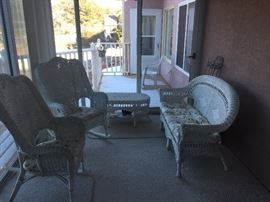 4 Piece Wicker Patio set. 2 rockers sofa and coffee table