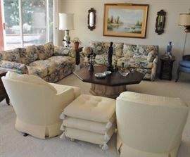 Upholstered swivel rockers, couches in great condition. Octagonal coffee table, stacked cushions.