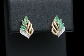 14K Yellow Gold, Emerald and Diamond Drop Earrings: A pair of 14K yellow gold, emerald and diamond drop earrings.
