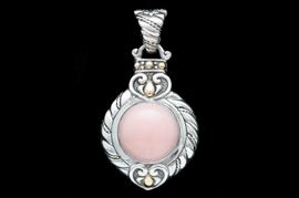 Sterling Silver, 18K Yellow Gold and Pink Opal Pendant: A sterling silver, 18K yellow gold and pink opal pendant.