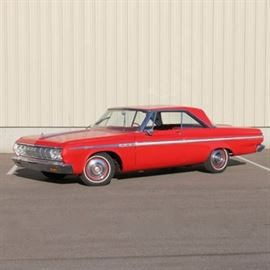 1964 Plymouth Sport Fury: A Classic 1964 Plymouth Sport Fury 2-door coupe in ruby red; VIN is 2341117775 and the odometer reads 94,617. Features includes a slant-6 cycle engine 225CL. Pointed fender and matching grille with a hardtop roofline. Push button automatic with an AM radio and cozy windows. Displays a current Massachusetts inspection sticker, #0920 0644 232 HIB CCD.