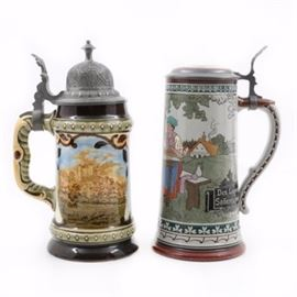 "German Stoneware Steins including Albert Thewalt: A grouping of two early 20th-century German stoneware steins. Albert Thewalt half liter stein, #469, with a hand painted figural scene and text that reads, ""Des Lebens Sonnenschein ist trinken, fröhlichsein (Drink and be merry for that's the joy of life)."" A German stein with impressed #1935 to the underside and a hand decorated print under glaze landscape scene. Both appear with pewter lids."