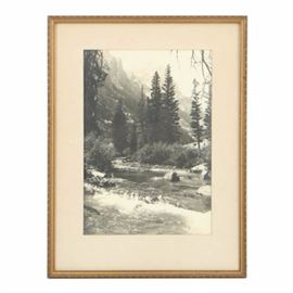 "Harrison Crandall Silver-Gelatin Photo ""The Icy Waters of Cascade Canyon"": A silver-gelatin photograph titled The Icy Waters of Cascade Canyon by American photographer and painter Harrison Crandall (1887-1970). This black and white photograph features a winding creek of Cascade Canyon located in Grand Teton National Park. A blind copyright stamp is present to the lower left, reading ""Crandall © Grand Teton National Park"". To the verso, the photograph is marked with a stamp that reads the title and ""Copyright by Crandall – Grand Teton National Park / 1068"". The work is presented under glass with light gray matting, and housed in a gold-tone wood frame with a low-relief pattern."