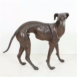 Bronze Life Size Greyhound Sculpture: A bronze life size sculpture depicting a greyhound, the dog posed standing and facing right.