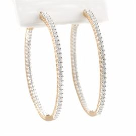 10K Yellow Gold 1.50 CTW Diamond In and Out Hoop Earrings: A pair of 10K yellow gold 1.50 ctw diamond in and out hoop earrings.