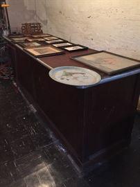 Lithographed tin, framed vintage prints, vintage bar.