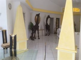 Venetian plaster obelisks with recessed wheels and secret storage