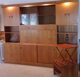 Taifo Danish modern teak wall unit and Jensen teak end table that stores folding tables!