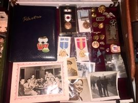 Showcase of WWll articles to include Photo's,  Photo Album,  Medals (Korea) Brass Medals and Buttons...