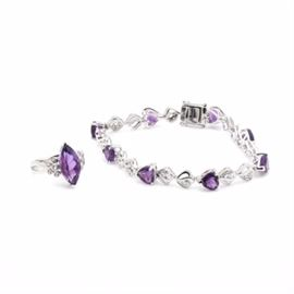 Sterling Silver Amethyst and White Topaz Jewelry: A selection of sterling silver jewelry consisting of a line bracelet set with heart-shaped amethysts, and a ring offering a marquise faceted amethyst center stone. Each piece is accented with white topaz.