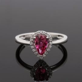 Platinum 1.05 CT Ruby and Diamond Ring With GIA Certificate: A platinum 1.05 ct ruby and diamond ring with GIA certificate report number 2185384334. This features an untreated ruby gemstone to the center of a pear shaped diamond border with an open under gallery.