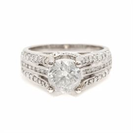 18K White Gold 2.39 CTW Diamond Ring: An 18K white gold 2.39 ctw diamond ring. This ring features a 1.59 ct center stone with diamonds cascading down the shoulders and showcased on the gallery.