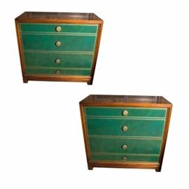 Green Leather Front Four Drawer Chest Pair by Tommi Parzinger for Charak Modern: A circa 1940s, Hollywood Regency style pair of low chests or nightstands by Tommi Parzinger for Charak Modern. They have simple mahogany cases with block feet and four drawers to the front. The drawers all have green, tooled leather fronts, with gold colored border and two circular brass handles. The top and bottom drawers are shallow, while the center two are deeper. The Charak Modern mark is inside a drawer.