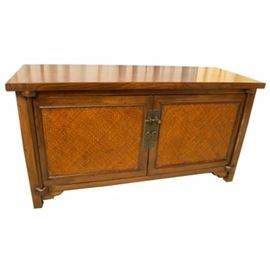 Asian Style Elm Cabinet: An Asian style cabinet in elm, having a rectangular top, above two framed doors with woven cane panels and brass latches. The interior has one shelf and the case rests on bracket feet.