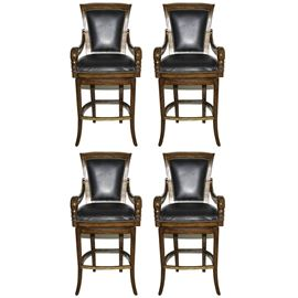 Black Leather Swivel Bar Stools: A set of four black leather swivel bar stools. The wooden bar stools have curved arms with carved leaf detailing to the front. They have black leather seats and backs with nailhead trim to the seat backs and front and back of the chairs. There are no maker identifications.