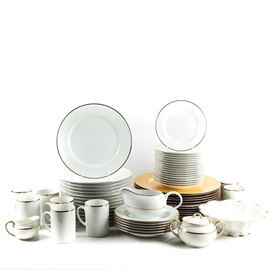White China Tableware Featuring Marketplace: A large set of formal tableware and serving pieces features Japanese maker Marketplace. The set includes thirteen golden wood charges, fourteen dinner plates, seven salad plates, six bowls, eight mugs, a sugar, a creamer, and a gravy boat. Also included is a ruffled bowl by Haviland Limoges.