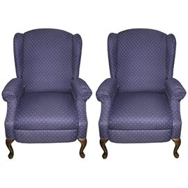 Queen Anne Style Upholstered Wingback Chairs: A pair of Queen Anne style upholstered armchairs. The chairs feature cabriole legs and blue and white upholstery with cushioned arms. There are no maker identifications.