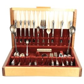 Holmes & Edwards Flatware Set of Eight and Burlwood Storage Chest: A Holmes Edwards flatware set of eight in a burlwood storage chest. The set comes with eight knives, eight butter knives, eight soup spoons, two serving spoons, a ladle, sixteen teaspoons, eight salad forks, eight dinner forks, a cheese knife, a meat serving fork, a sugar spoon and a William Rogers and son baby spoon and Sheffield England silver plated salad servers. It comes in a Holmes & Edwards tarnish resistant felt lined chest.