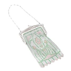 Vintage Art Deco Whiting & Davis Enameled Mesh Purse: A vintage Art Deco enameled mesh purse from Whiting & Davis. The purse is fashioned from silver tone metal and has a solid engraved frame with a center finial clasp holding a mesh bag with a painted floral design in a palette of pink and green. It has a link handle and is marked with the Whiting & Davis logo tag to the corner.