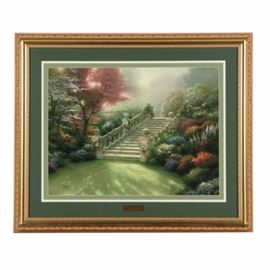 "Thomas Kinkade Limited Edition Offset Lithograph on Paper ""Stairway to Paradise"": A limited edition offset lithograph on paper titled Stairway to Paradise after an original painting by well-listed American ""Painter of Light"" Thomas Kinkade (1958 – 2012). This print depicts a marble staircase is a lush garden blooming with colorful flowers with sunlight streaming through a tree covered with pink blooms. The piece is signed in plate to the lower right and signed and numbered 480 in an edition of 3850 by hand to the lower left. A brass plaque with the title and the artist's name is attached to the lower edge of the mat and a certificate of authenticity is included in an envelope affixed to the verso. The print is presented behind a layered green mat, behind glass, in a wooden frame with hanging brackets to the verso."