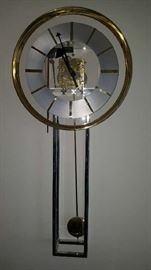 glass and chrome Howard Miller wall clock with exposed gears Designed by George Nelson.