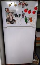 Magic Chef refrigerator     (ATTACHED GARAGE)