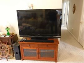 Large TV dated 2010 in wonderful condition. The stand is a beauty and separately priced as is the Woofer and sound bar. But a package deal can be had!