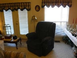 This is a light blue automatic reclining and lift chair. The window light kept messing up the shot.