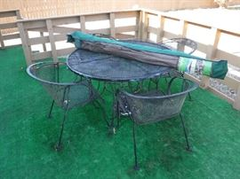 Metal table with 4 chairs and also a nicer umbrella with stand