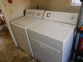 Washer and Dryer in full working order. I do not know how old but looks very recent.
