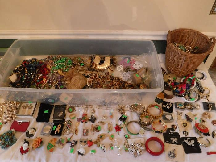 Lots of clip-on earrings. The woman did not have pierced ears. Most of this jewelry in these totes and baskets is priced under $5 each to $1.