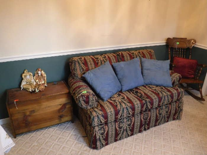 Very nice loveseat and carved rocker.