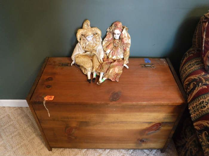 Small cedar trunk with 2 Venetian dolls on top. The cover to the trunk needs a couple of screws