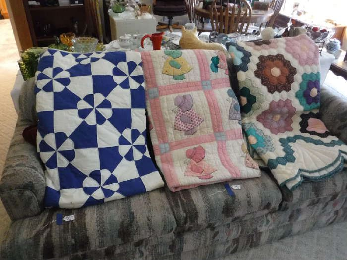 3 of the 4 quilts I have. I believe 2 at least look hand-stitched. Not are priced over $95.