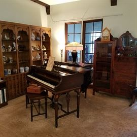 View in Living Room showing one of the Side-by-Side secretaries, and the antique Fischer grand piano