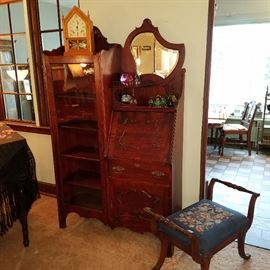 Side-by-side mahogany finish secretary.  Part of paperweight collection displayed
