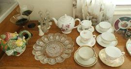 PORCELAIN CUPS AND TEA POTS