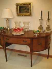 Curved vintage buffet with crystal accessories and antique oil painting
