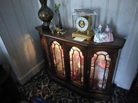 Curio filled with Royal Doulton ladies, Atmos clock, cloisonne vase