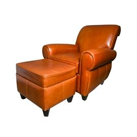 Russet Colored Leather Lounge Chair and Ottoman: A russet colored, leather lounge chair and matching ottoman. The chair has a rolled back and arms, above a removable seat cushion and tight apron. Each piece rests on four tapered feet.