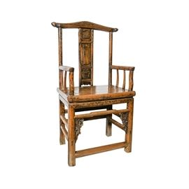 Antique Chinese Yoke-Back Elm Arm Chair: An antique Chinese elm arm chair, having traces of black paint and a yoke-back, over a paneled splat, shaped arms with spindled supports and a framed plank seat. Below is a framed base with carved brackets and through-tenon stretchers.