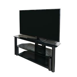 "Samsung 36"" Television with Tempered Glass And Metal Media Stand: A Samsung 36"" television with tempered glass and metal stand. The television features a black finish and the stand features three shelves for storage of the television and other audio/visual equipment and media."